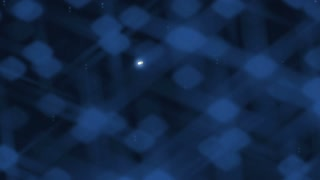 The iridescent dark blue background. Gradually appear white sparkling snowflakes