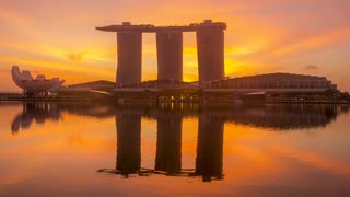 Dawn in Singapore on the Background of Marina Bay Sands Hotel. Time Lapse