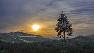 Dawn over Winter Wooded Mountains and Fogs. Time Lapse