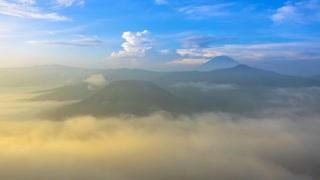 Morning Mist and Active Volcanoes. Time Lapse