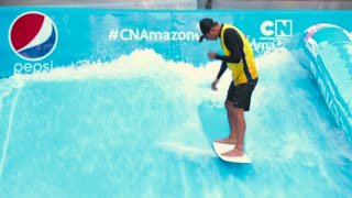 A man falls in the water park with surfboards