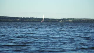 A small sailing boat on the water