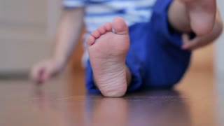 Bare feet of a little boy