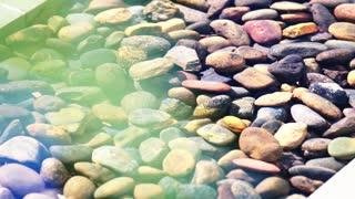 Beautiful stones flat shape under water. Making decor