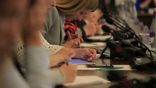 Belgorod, RUSSIA - September 15, 2016 Press Conference Reporters carefully listening to the speaker. Making notes in notepad