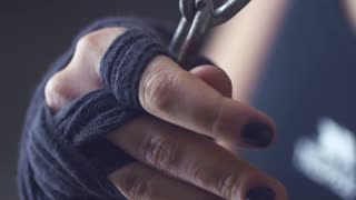 Close-up of a girl pulls on the hand chain