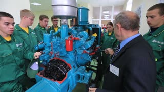 Demetrius Agricultural College. professor tells students tractor engine unit