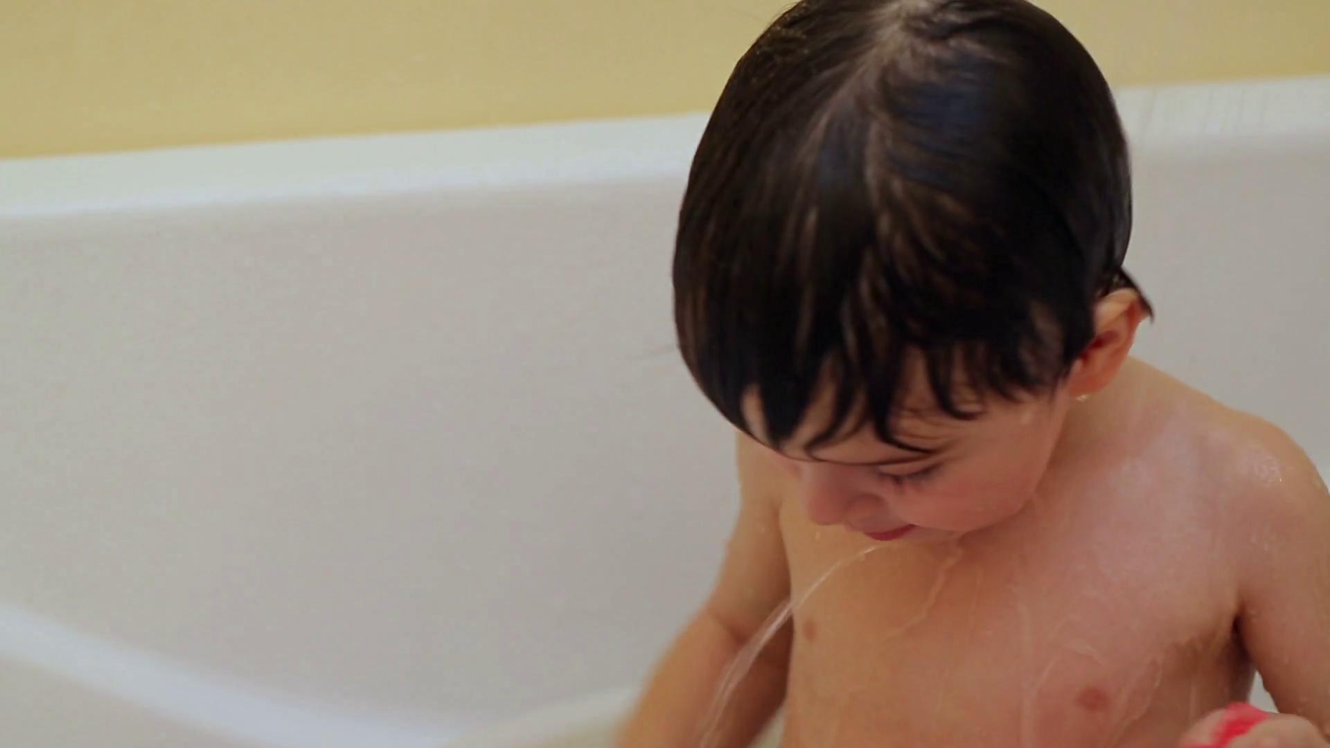 Emotional little boy taking a bath alone.  Stock Video Footage - Storyblocks