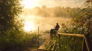 Fisherman at sunrise fishing on the float rod
