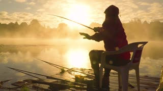 Fisherman at sunrise fishing on the float rod