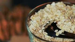 Flakes of oatmeal in a glass