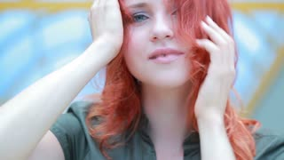 Girl posing touching red hair