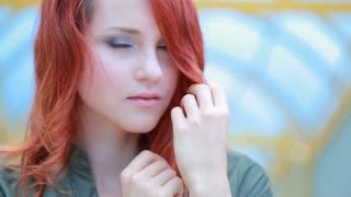 Girl posing touching red hair