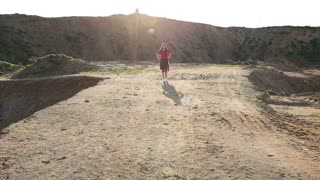 Girl walking on the sand pits.