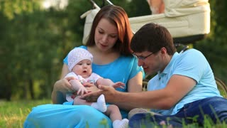 Happy family of three, with a baby, blue-eyed girl.