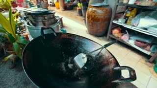 In a large copper bowl brewed coconut sugar. nice color natural product. Asian cooking traditions.
