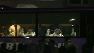 Kazakhstan Baikonur Launch 17 November 2016 Astronauts waving from the window of the bus.