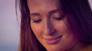 Light eyes freckles on her face, lovely smile.
