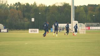 Minsk - 5 September 2016: Open training French football team in Minsk. Players warm up the French team on the football field