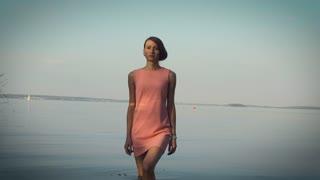 Modest girl walking near the water body
