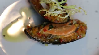 mussels stuffed with vegetables. Colorful beautiful dish decorated with verdure