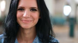 Smiling brunette girl, close-up