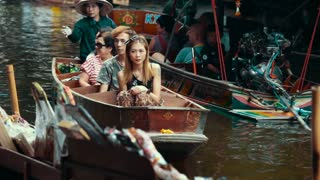 Thailand Bangkok November 20 Asian woman with a big hat on a boat carries tourists to the floating market