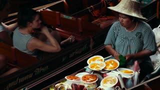 Thailand Bangkok November 20 Woman on the boat driving up food.
