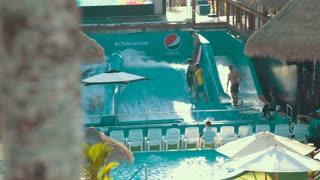 Thailand Bangkok November 21 Men ride on a surf doskah. Na water slide at a water park
