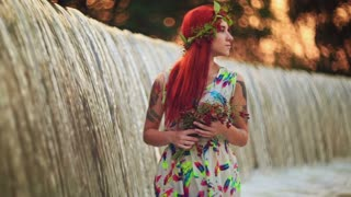 The girl with red hair near the waterfall.