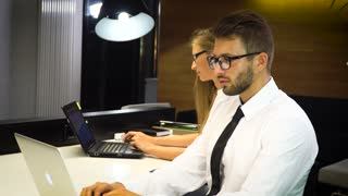 The team of young businesspeople working in office