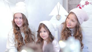 Three young beautiful girls in winter hat