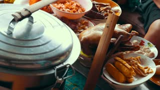 Asian cuisine, cooking right on the street for tourists.