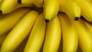 Bananas. A bunch of bananas rotates, an interesting foreshortening, an advertising shot.