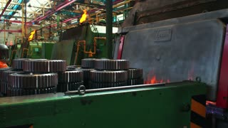 Hardening of machine parts in the furnace under high temperature. Large Steel Works. Rolled metal factory