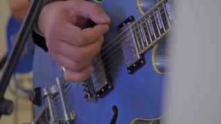 Man playing the guitar, hand close-up