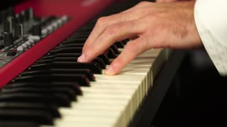 Man plays the piano chord