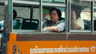 Thailand Bangkok November 20 2016 Woman on the bus looking out the window