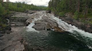 Waterfall in Sweden on a stormy mountain river