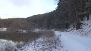 Winter landscape with river and forest.