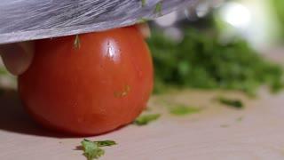 Woman cuts tomato