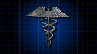 Caduceus 101: The Caduceus medical symbol rotates on a blue grid (Loop).