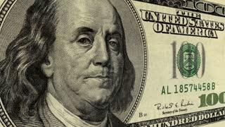 Cash 002: Close up on president Benjamin Franklin on a one hundred dollar bill (Loop).