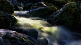 Hyper Nature 0404: Misty waters flow through giant rocks (Loop).