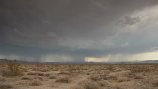 Time Lapse 0508: Time lapse storm clouds and lightning on a desert plain.