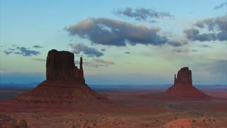 Time Lapse 2052: Time lapse clouds travel over Monument Valley National Monument in Utah.