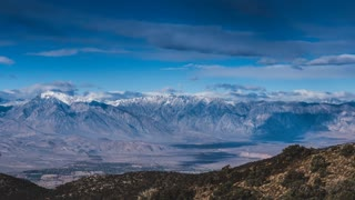 Time lapse clouds travel over the High Sierra Mountains, California.