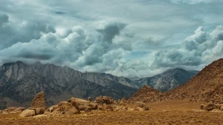 Time lapse storm clouds travel over the Sierra Mountains in Lone Pine, California.