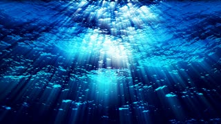 Underwater ocean waves ripple and flow with light rays (Loop).