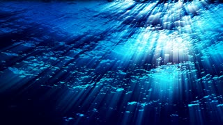 Underwater ocean waves ripple and flow with light rays (Loop).